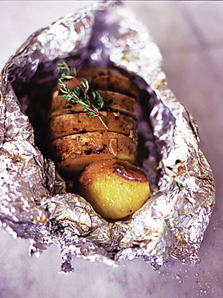 Garlic, thyme and anchovy baked potatoes