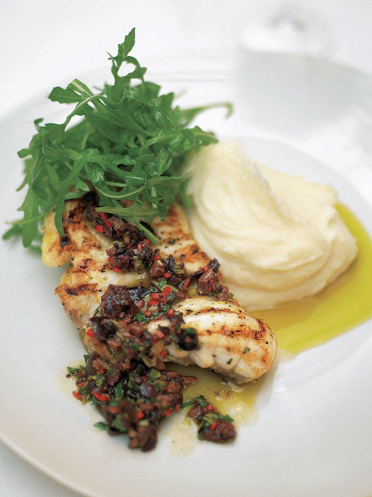 Grilled or roasted monkfish with black olive sauce and lemon mash