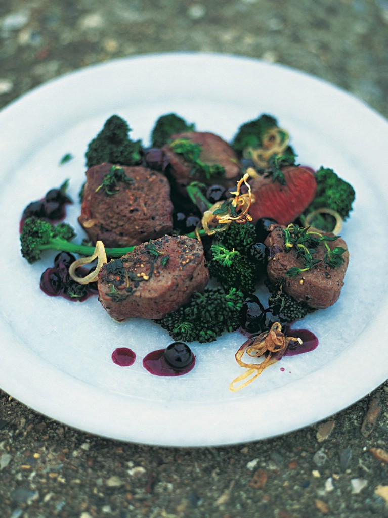 Pan-seared venison with blueberries, shallots and red wine
