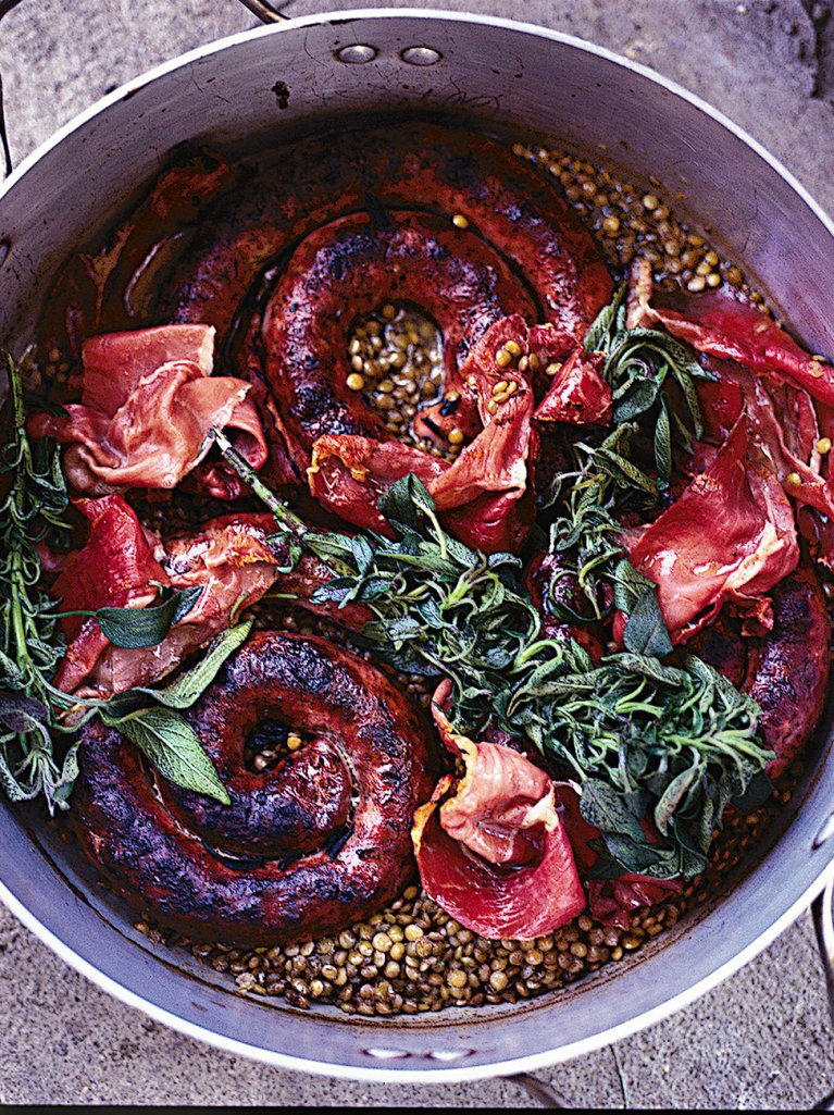 The best sausages with braised lentils and crispy prosciutto