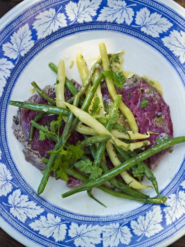 Beef carpaccio with marinated bean salad