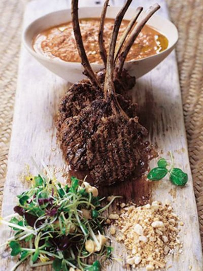 Barbecued lamb lollipops with spiked houmous & nuts