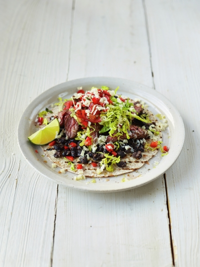Sizzling steak burritos with black beans & pepper & tomato salsa